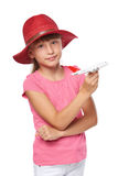 Lovely little girl wearing tourist hat holding small airplane toy Royalty Free Stock Images