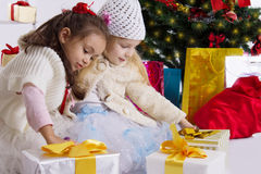 Lovely little girls with presents under Christmas Stock Images