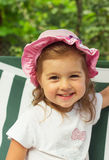 Lovely little kid is smiling outdoors Royalty Free Stock Images