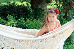 Lovely long blond hair child in hammock outside Royalty Free Stock Images
