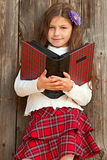 Lovely long-haired smiling girl with book Royalty Free Stock Photo