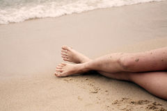 Lovely long legs at the beach Royalty Free Stock Photo