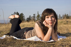 Lovely looking brunette on meadow 4 Stock Photo