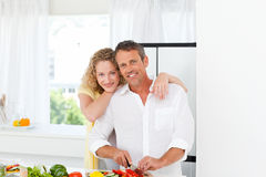 Lovely lovers looking at the camera Royalty Free Stock Photography