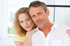 Lovely lovers looking at the camera Royalty Free Stock Photo