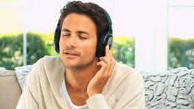 Lovely man listening to music stock video
