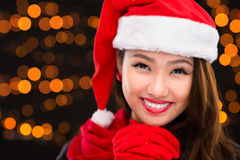 Lovely x-mas girl. Copy-spaced portrait of a lovely x-mas lady over a shiny background Royalty Free Stock Photo