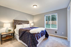 Lovely master bedroom with soft grey walls Royalty Free Stock Photo