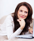 Lovely mature woman using laptop while at home Stock Photography