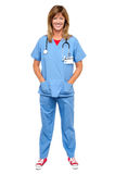 Lovely medical expert with hands in pocket Stock Image