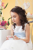 Lovely melancholy little girl drinking tea Stock Photography