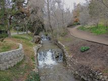 Memory Grove Park views of Waterfalls and streams leading into a small pond or lake surrounded by walking paths and trees in Salt. Lovely Memory Grove Park views Royalty Free Stock Images