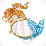 Lovely mermaid with flowing long hair holding a big mirror Stock Photo