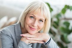 Lovely middle-aged blond woman with beaming smile stock photography