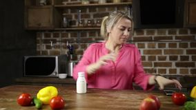 Stressed woman rushing for work in the kitchen stock video