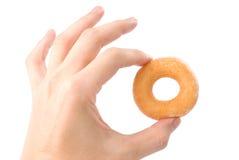 Lovely mini donut in man's hand Stock Images
