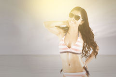 Lovely model with swimsuit on the coast Stock Photos
