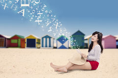 Lovely model with tablet at seaside Stock Photography