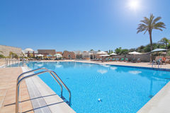 Lovely modern swimming pool for a relaxing family holiday . stock photo