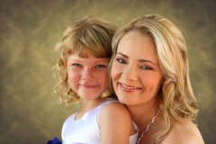 Lovely mom and daughter studio photo Stock Image