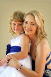 Lovely mom and daughter studio photo Stock Photo