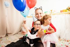 Lovely mom with her kids. Cute mother celebrating birthday party with her kids Stock Image