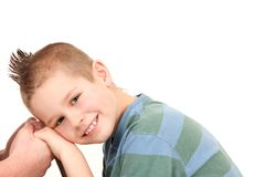 Lovely moment of young boy with punk hairstyle Stock Photo
