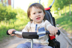 Lovely 20 months baby boy on bike Royalty Free Stock Photo