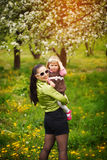 Lovely mother and child together smiling outdoors Royalty Free Stock Photography