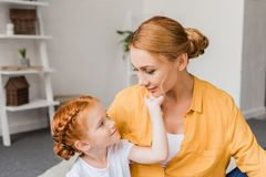 Lovely mother and daughter. Looking at each other at home Royalty Free Stock Image