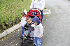 Lovely Mother with Her Children Stock Photos