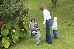Lovely Mother With Her Children Outdoors Stock Photos