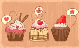 Lovely muffins. Three lovely muffins on orange shabby backdrop Stock Photography
