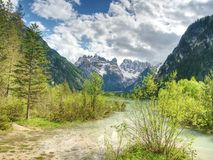 Lovely nature scenery with rocky peaks above beautiful lake. Royalty Free Stock Photos