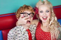Lovely nerds. Girl is making a fun of a nerdy boyfriend Royalty Free Stock Photo