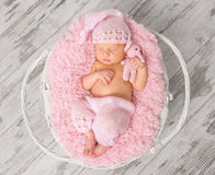 Lovely newborn girl in pink panties and hat in basket Stock Photo