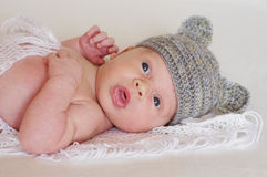 Lovely newborn in gray hat Stock Photo