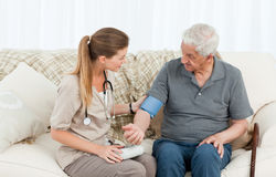 Lovely nurse helping her patient to do exercises Royalty Free Stock Photography
