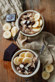 A lovely oatmeal dessert with banana and chocolate Stock Photo