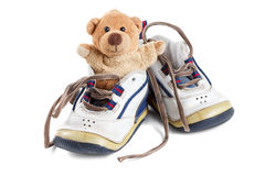 Lovely old Baby's shoes with a teddy bear Stock Image