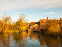 Lovely old constable mill house flatford river surface autumn tr. Ees light; essex; england; uk Stock Image