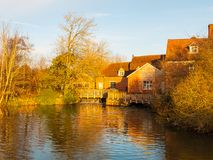 Lovely old constable mill house flatford river surface autumn tr. Ees light; essex; england; uk Royalty Free Stock Images