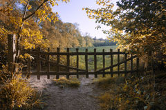 Lovely old gate into countryside field Autumn landscape Royalty Free Stock Photos