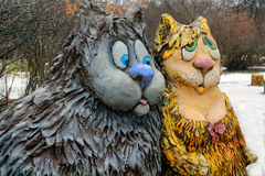 Lovely Pair of Cats. Wooden sculpture of pair of cats in love in one of the Moscow parks, Russia Royalty Free Stock Images