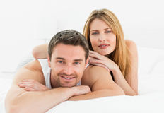 Lovely pairs lying down together Royalty Free Stock Photo