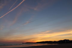 Lovely panoramic view just before sunrise of silhouette of deux jumeaux in colorful summer sky on a sandy beach Royalty Free Stock Image