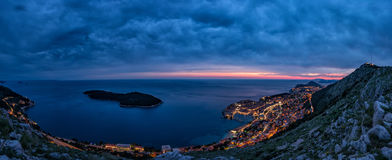 Lovely panoramic view of the old walled city of Dubrovnik with bird`s eye view at night. royalty free stock image