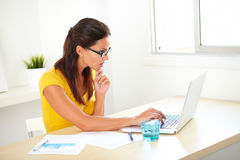 Lovely pensive secretary sitting in her workplace Stock Photography