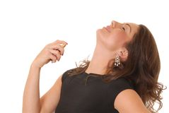 Lovely Perfume Lady 2. Beautiful girl applying perfume to her neck Royalty Free Stock Images