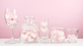 The lovely pink heart marshmallows on white table Stock Image